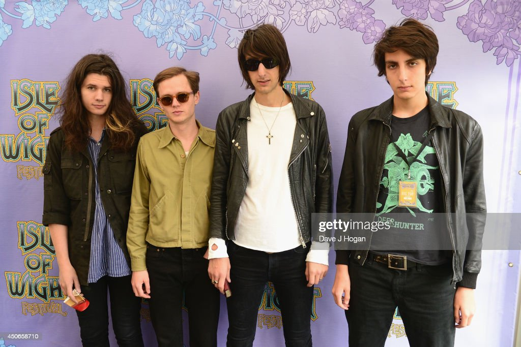 Joshua Hayward, Joe Spurgeon, Faris Badwan and Rhys Webb of The Horrors pose backstage at The Isle of Wight Festival at Seaclose Park on June 15, 2014 in Newport, Isle of Wight.