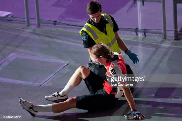 Joshua Heather is given medical assistance after crashing into the barriers during the 40km Talent Cup Madison Race at The Six Day Cycling Series on...