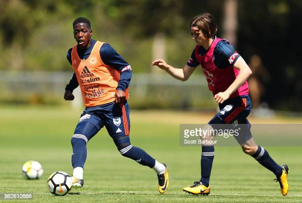 Joshua Hope and Leroy George of the Victory compete for the ball during a Melbourne Victory ALeague training session at Gosch's Paddock on October 18...