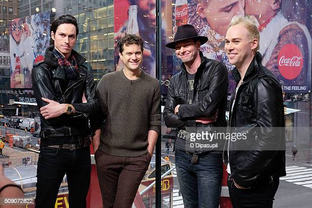 Joshua Jackson and Key Shade and Nathan Samuel Phillip of the band Menew visit 'Extra' at their New York studios at HM in Times Square on February 8...