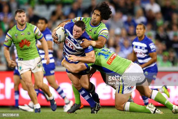Joshua Jackson of the Bulldogs is tackled during the round five NRL match between the Canberra Raiders and the Canterbury Bulldogs at GIO Stadium on...