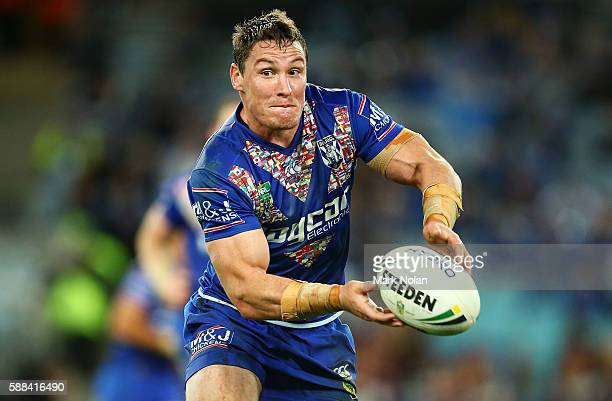 Joshua Jackson of the Bulldogs looks to pass during the round 23 NRL match between the Canterbury Bulldogs and the Manly Sea Eagles at ANZ Stadium on...