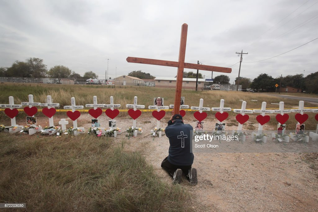 Joshua John of Roanoke, Virginia prays at a memorial where 26 crosses were placed to honor the 26 victims killed at the First Baptist Church of Sutherland Springs on November 9, 2017 in Sutherland Springs, Texas. On November 5, a gunman, Devin Patrick Kelley, shot and killed the 26 people and wounded 20 others when he opened fire during Sunday service at the church.