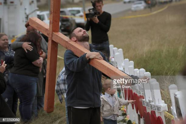 Joshua John of Roanoke Virginia prays at a memorial where 26 crosses were placed to honor the 26 victims killed at the First Baptist Church of...