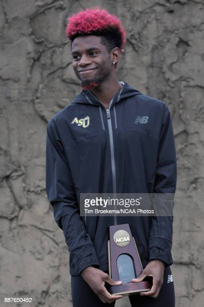 Joshua Joseph of Adams State University is photographed with his ninth place trophy during the Division II Men's Cross Country Championship held at...