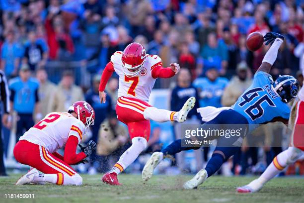 Joshua Kalu of the Tennessee Titans blocks a game tying field goal attempt at the end of the game by Harrison Butker of the Kansas City Chiefs at...