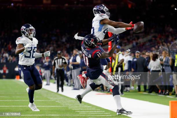 Joshua Kalu of the Tennessee Titans breaks up a pass intended for Steven Mitchell of the Houston Texans in the fourth quarter at NRG Stadium on...