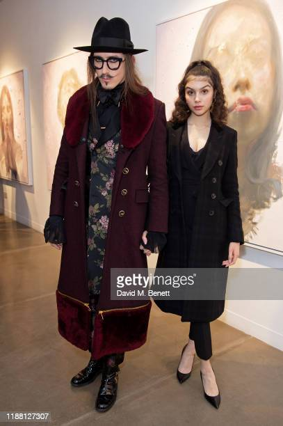 Joshua Kane and Anastasiya Higgins attend a private view of Lethe by Henrik Uldalen at JD Malat Gallery on December 12 2019 in London England