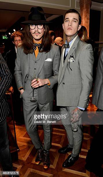 Joshua Kane and Jimmy Q attend the Dolce Gabbana London Collections Men event at the Dolce Gabbana New Bond Street store on January 5 2014 in London...