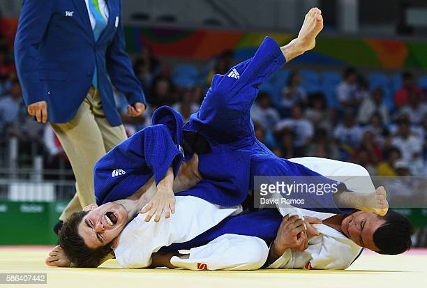 Joshua Katz of Australia competes against Diyorbek Urozboev of Uzbekistan in the Men's 60 kg Judo on Day 1 of the Rio 2016 Olympic Games at Carioca...
