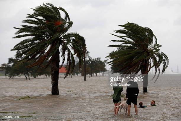 Joshua Keegan and Ruffin Henry swim in water coming ashore from Lake Pontchartrain as Hurricane Isaac approaches on August 28 2012 in New Orleans...