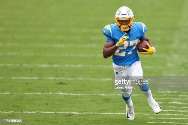 Joshua Kelley of the Los Angeles Chargers runs for yardage during the second quarter of a game against the Tampa Bay Buccaneers at Raymond James...