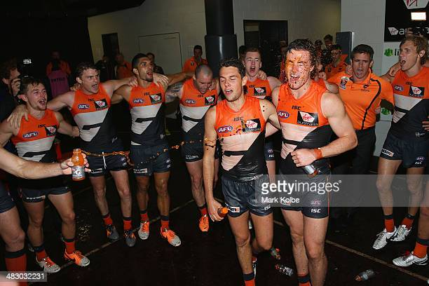Joshua Kelly and Lachie Plowman of the Giants lead the victory song as the Giants celebrate victory during the round three AFL match between the...
