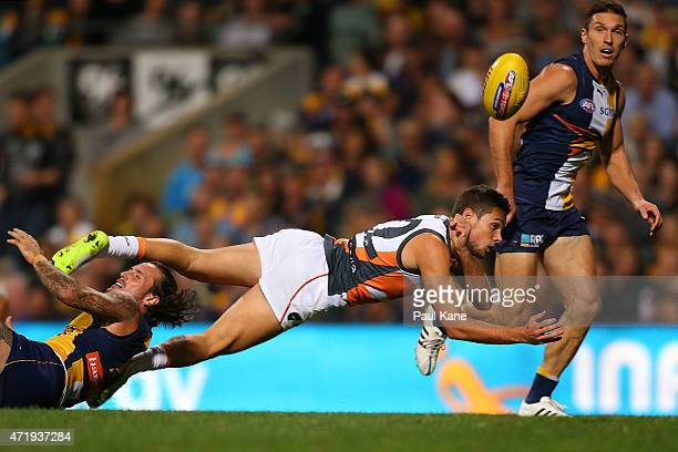 Joshua Kelly of the Giants handballs during the round five AFL match between the West Coast Eagles and the Greater Western Sydney Giants at Domain...