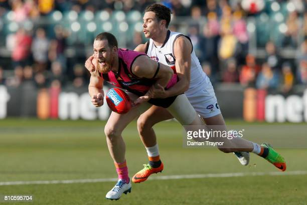 Joshua Kelly of the Giants tackles Jarryd Roughead of the Hawks during the round 16 AFL match between the Hawthorn Hawks and the Greater Western...