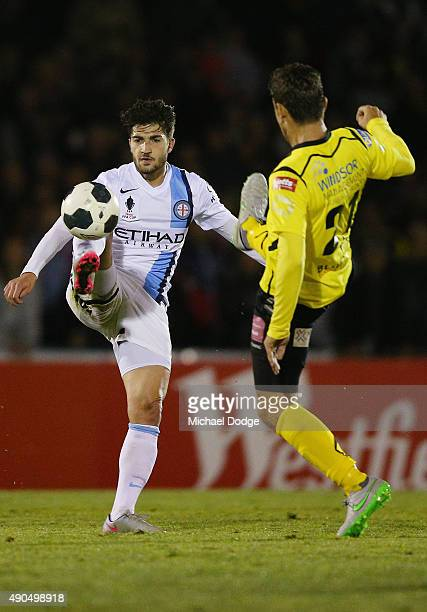 Joshua Kennedy of Melbourne City and Kostas Katsouranis of United compete for the ball during the FFA Cup Quarter Final match between Heidleberg...