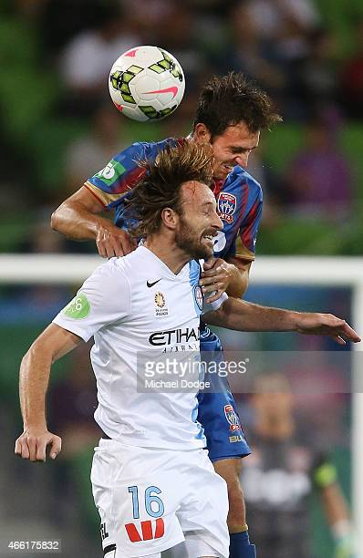 Joshua Kennedy of Melbourne City heads the ball away from Ben Kantarovski of the Jets during the round 21 ALeague match between Melbourne City FC and...