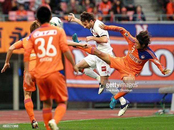 Joshua Kennedy of Nagoya Grampus heads the ball during the JLeague match between Albirex Niigata and Nagoya Grampus at Tohoku Denryoku Big Swan...