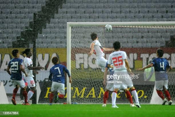 Joshua Kennedy of Nagoya Grampus scores the second goal during the J.League match between Yokohama F. Marinos and Nagoya Grampus at Nissan Stadium on...