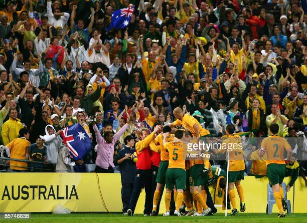 Joshua Kennedy of the Socceroos celebrates with team mates after scoring during the 2010 FIFA World Cup qualifying match between the Australian...
