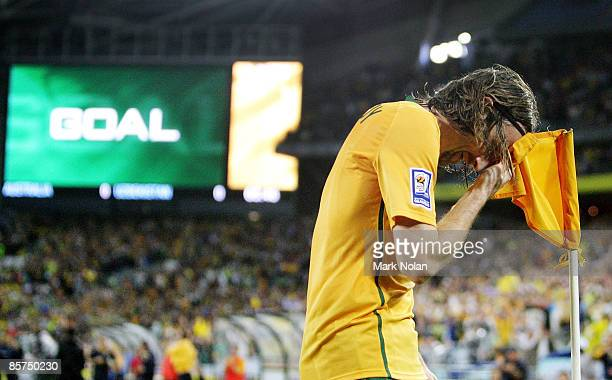 Joshua Kennedy wipes his brow on the corner flag after scoring during the 2010 FIFA World Cup qualifying match between the Australian Socceroos and...