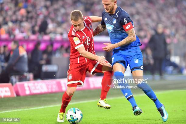 Joshua Kimich of Bayern Munich in action against Kevin Vogt of 1899 Hoffenheim during a Bundesliga match between FC Bayern Munich and 1899 Hoffenheim...