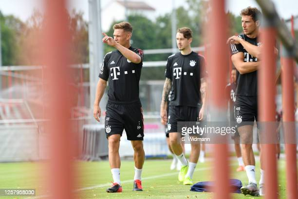 Joshua Kimmich Adrian Fein and Leon Goretzka of Bayern Muenchen look on during a training session at Saebener Strasse training ground on July 24 2020...
