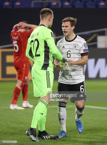 Joshua Kimmich and goalkeeper Marc-Andre ter Stegen of Germany react during the FIFA World Cup 2022 Qatar qualifying match between Germany and North...