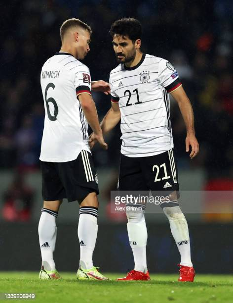 Joshua Kimmich and Ilkay Guendogan of Germany shake hands after the 2022 FIFA World Cup Qualifier match between Iceland and Germany at...