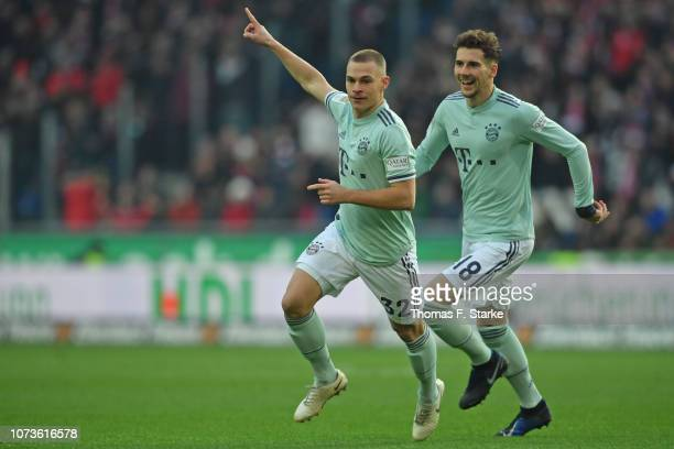 Joshua Kimmich and Leon Goretzka of Muenchen celebrate their teams first goal during the Bundesliga match between Hannover 96 and FC Bayern Muenchen...