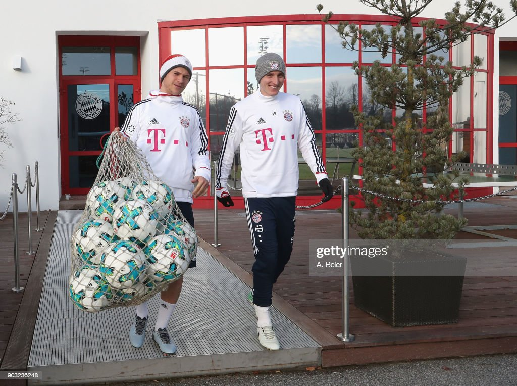 Joshua Kimmich (L) and Sebastian Rudy of FC Bayern Muenchen arrive for a training session at the club's Saebener Strasse training ground on January 10, 2018 in Munich, Germany.