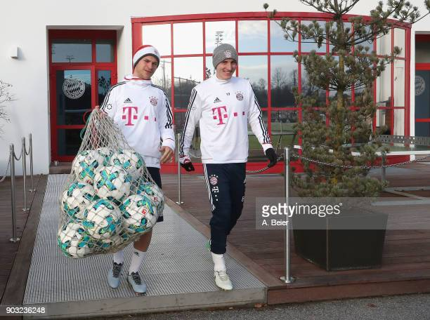 Joshua Kimmich and Sebastian Rudy of FC Bayern Muenchen arrive for a training session at the club's Saebener Strasse training ground on January 10...