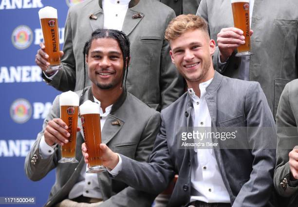 Joshua Kimmich and Serge Gnabry of FC Bayern Muenchen pose with beer mugs during the FC Bayern Muenchen and Paulaner photo session at FGV Schmidtle...