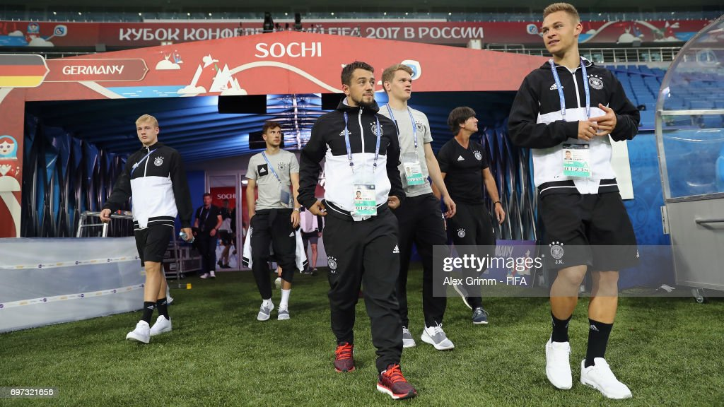 Joshua Kimmich (R) and team mates walk out of the tunnel for a Germany training session during the FIFA Confederations Cup Russia 2017 at Fisht stadium on June 18, 2017 in Sochi, Russia.