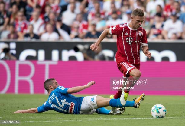 Joshua Kimmich gets separated fromthe ball by Dries Mertens during the Audi Cup SSC Naples vs Bayern Munich match at the Allianz Arena in Munich...
