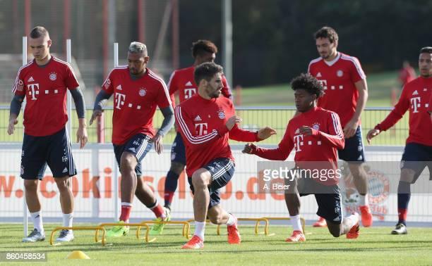 Joshua Kimmich Jerome Boateng Kingsley Coman Javi Martinez David Alaba Mats Hummels and Corentin Tolisso of FC Bayern Muenchen warm up during a...