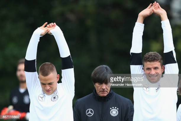 Joshua Kimmich Joachim Loew head coach of Germany and Thomas Mueller of Germany during a team Germany training session at Kleine Kampfbahn Stadium on...