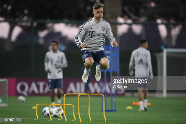 Joshua Kimmich jumps during a training session on day three of the FC Bayern Muenchen winter training camp at Aspire Academy on January 06, 2020 in...
