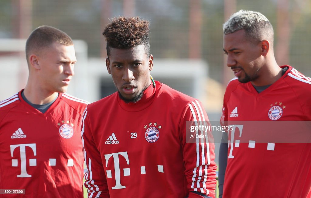 Joshua Kimmich, Kingsley Coman and Jerome Boateng (L-R) of FC Bayern Muenchen are pictured during a training session at the Saebener Strasse training ground on October 12, 2017 in Munich, Germany.