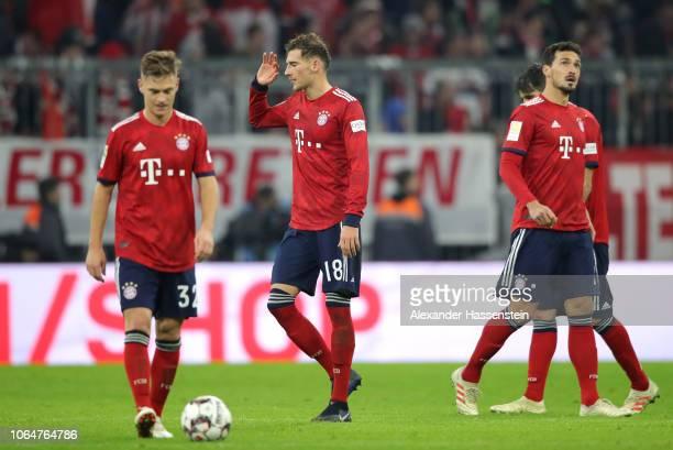 Joshua Kimmich Leon Goretzka and Mats Hummels of Bayern Munich react following the Bundesliga match between FC Bayern Muenchen and Fortuna...