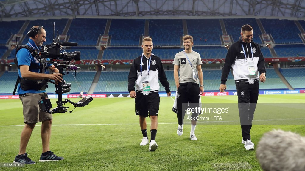 Joshua Kimmich, Leon Goretzka and Niklas Suele (L-R) walk on the pitch during a Germany training session during the FIFA Confederations Cup Russia 2017 at Fisht stadium on June 18, 2017 in Sochi, Russia.