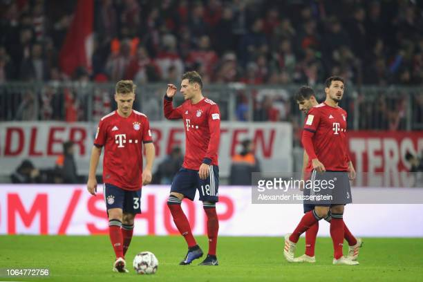 Joshua Kimmich Leon Goretzka Javier Martinez and Mats Hummels of Muenchen react after receiving the 3rd goal during the Bundesliga match between FC...