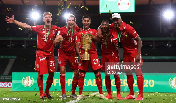 Joshua Kimmich Leon Goretzka Serge Gnabry David Alaba and Jerome Boateng of Bayern Muenchen celebrate with the trophy during the DFB Cup final match...