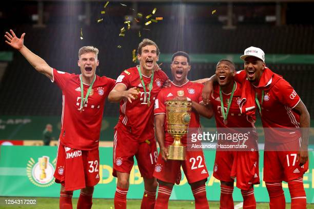 Joshua Kimmich Leon Goretzka Serge Gnabry David Alaba and Jerome Boateng of FC Bayern Muenchen pose with the trophy in celebration after the DFB Cup...