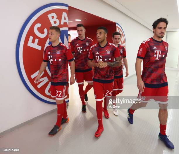 Joshua Kimmich Niklas Suele Corentin Tolisso Sebastian Rudy and Mats Hummels of FC Bayern Muenchen arrive at the players' tunnel for the Bundesliga...