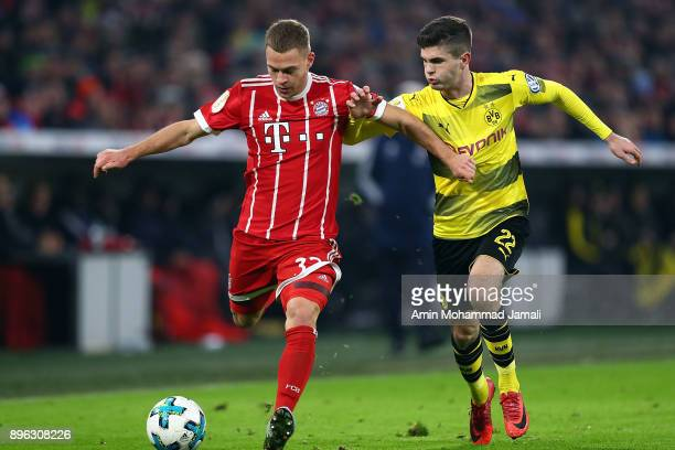 Joshua Kimmich of Bayern Muenchen and Christian Pulisic of Borussia Dortmund in action during match between Bayern Muenchen v Borussia Dortmund DFB...