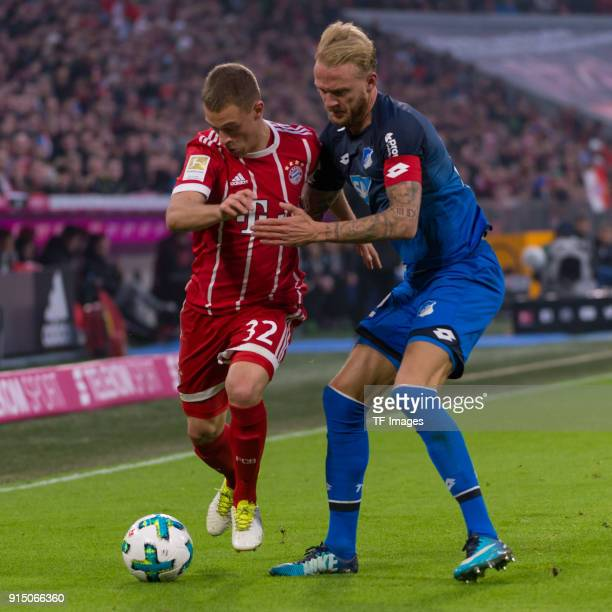 Joshua Kimmich of Bayern Muenchen and Kevin Vogt of Hoffenheim battle for the ball during the Bundesliga match between FC Bayern Muenchen and TSG...