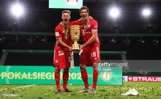 Joshua Kimmich of Bayern Muenchen and Leon Goretzka of Bayern Muenchen celebrate with the trophy during the DFB Cup final match between Bayer 04...