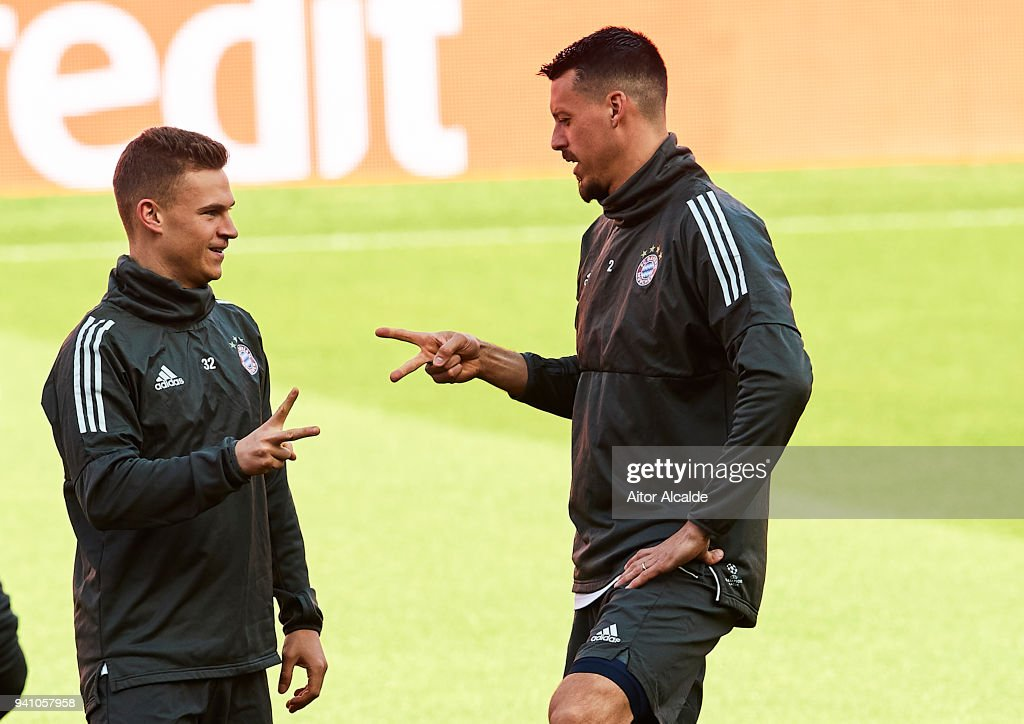 Joshua Kimmich of Bayern Muenchen (L) and Sandro Wagner of Bayern Muenchen during the Training Session prior to their UEFA Champions League match against Sevilla FC at Estadio Ramon Sanchez Pizjuan on April 2, 2018 in Seville, Spain.