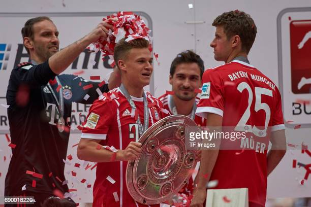 Joshua Kimmich of Bayern Muenchen and Thomas Mueller of Bayern Muenchen poses with the Championship trophy in celebration of the 67th German...